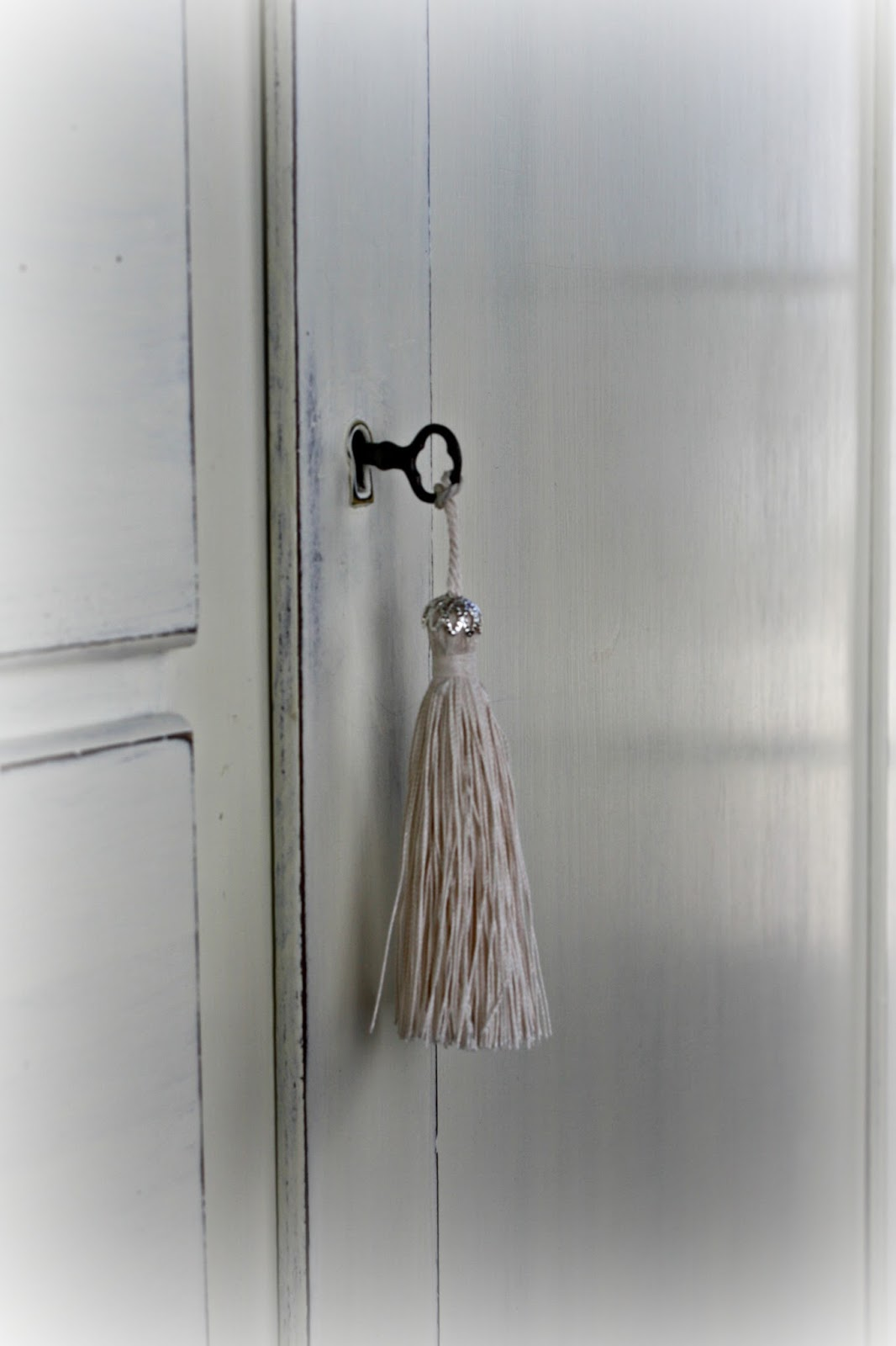 Hand dyed tassel on vintage key.