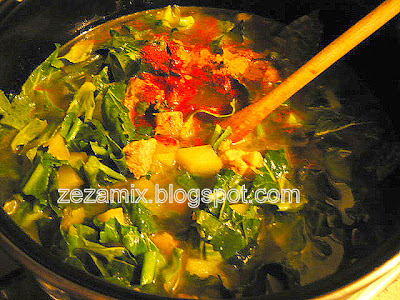 Preparation of vegetable stew, meat and chickpea