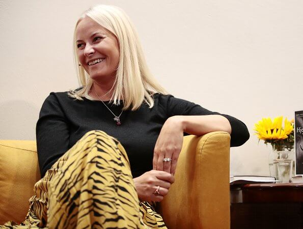 Crown Princess Mette-Marit wore RIXO Tina pleated tiger print silk crepe de chine skirt at Aschehoug Publishing House