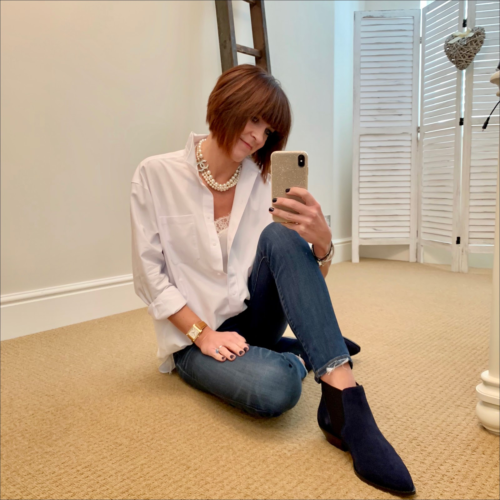 my midlife fashion, chanel pearl choker necklace, the whtie company lace trim silk camisole, and other stories oversized shirt, j crew 8 inch toothpick skinny jeans, marks and spencer western suede ankle boots