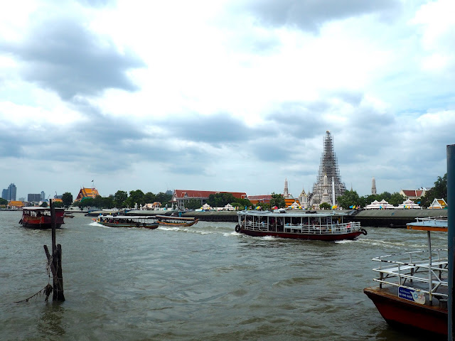 Chao Phraya river and Wat Arun in the centre of Bangkok, Thailand