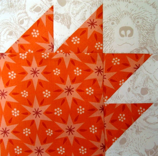 traditional red and white bear paw quilt block