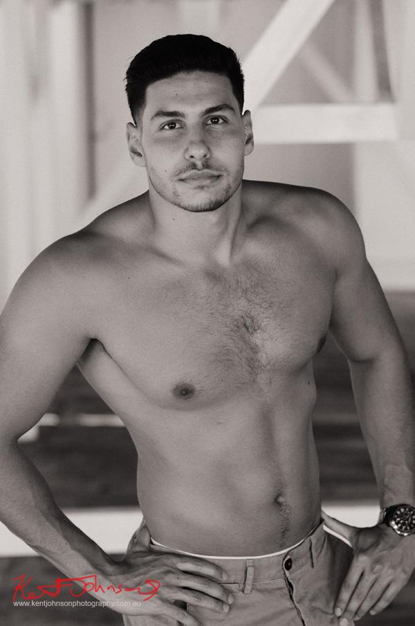 Body shot in black and white. Male modelling portfolio shot on Location in Sydney Australia by Kent Johnson.