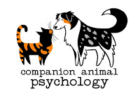 Happy cats, happy dogs, thanks to science. About Companion Animal Psychology blog; logo is pictured.