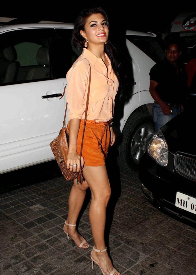 Jacqueline Fernandez Long Legs Stills In Orange Shirt Mini Short