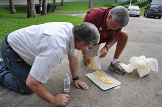 Two teachers practice casting a footprint.