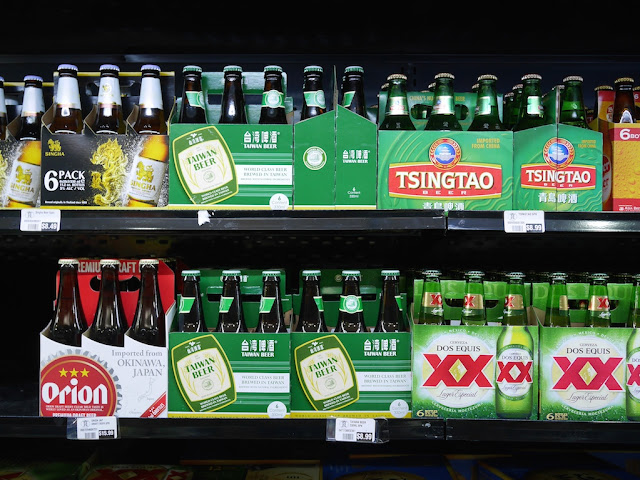 selection of six-packs of beer including Taiwan Beer and Tsingtao