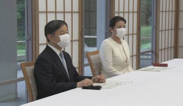 At Akasaka Imperial Residence. Empress Masako is wearing pearl earrings pearl necklace and white tweed jacket and skirt