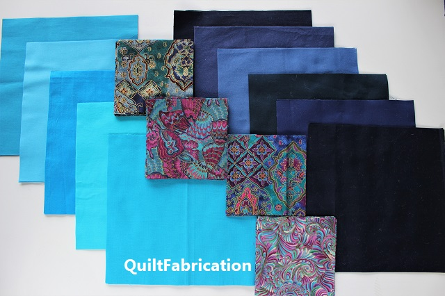 fabric pieces for the Summer quilt in blue and aqua