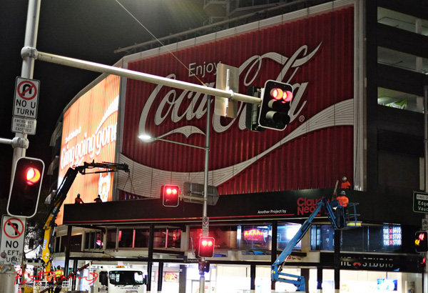 Kings Cross Coke sign, Dismantling the Work Deck - Street Fashion Sydney by Kent Johnson.