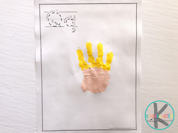 press hand on printable letter q paper