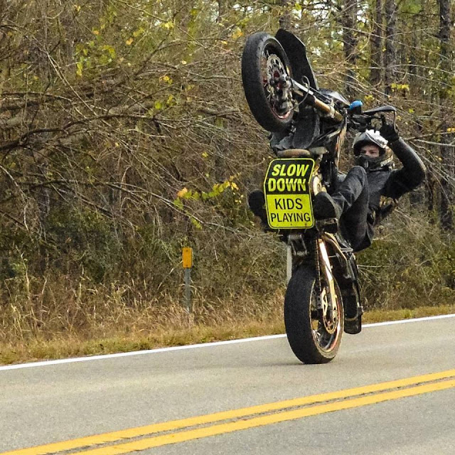 Slow Down Kids Playing - Supermoto Wheelie