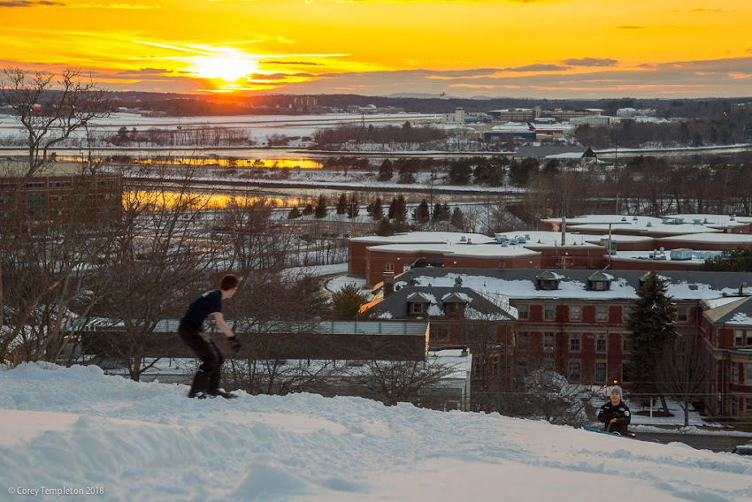 Portland, Maine USA February 2018 photo by Corey Templeton of snowboarding on the Western Promenade hill at sunset in the West End