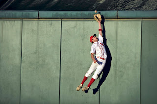 Baseball player makes a leaping catch