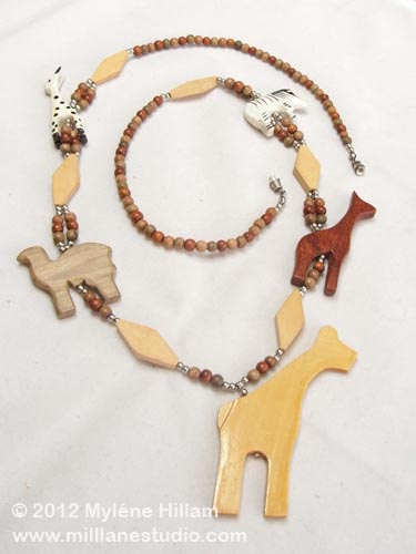 On Safari animal necklace restrung with wooden beads.