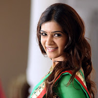sparkling and blooming Samantha in green half saree