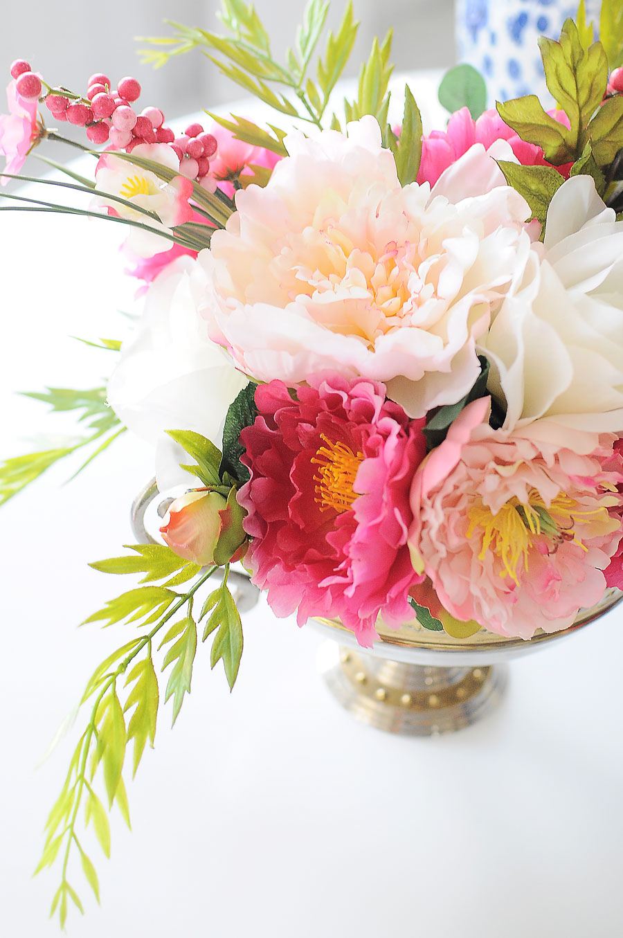 DIY pink and white peony faux floral arrangement tutorial using a trophy vase and dry floral foam. Love this idea for spring home decor or a centerpiece.
