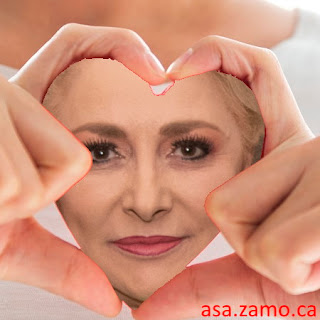 Viorica Dancila portrait enclosed by fingers shaped as a heart symbol
