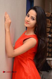 Telugu Actress Divya Nandini Stills in Orange Sleeveless Gown at Chennai Chaitrama Movie le Launch Event  0056.JPG