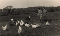 Landgirls feeding tablescraps to pastured poultry