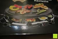 Verpackungsaufdruck: Andrew James – Traditioneller Raclette Grill für 8 Personen mit thermostatischer Hitzekontrolle – Inklusive 8 Raclette-Spachteln – 2 Jahre Garantie