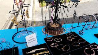 beaded bracelets, pendants on rattail cord, woven copper wire bracelets