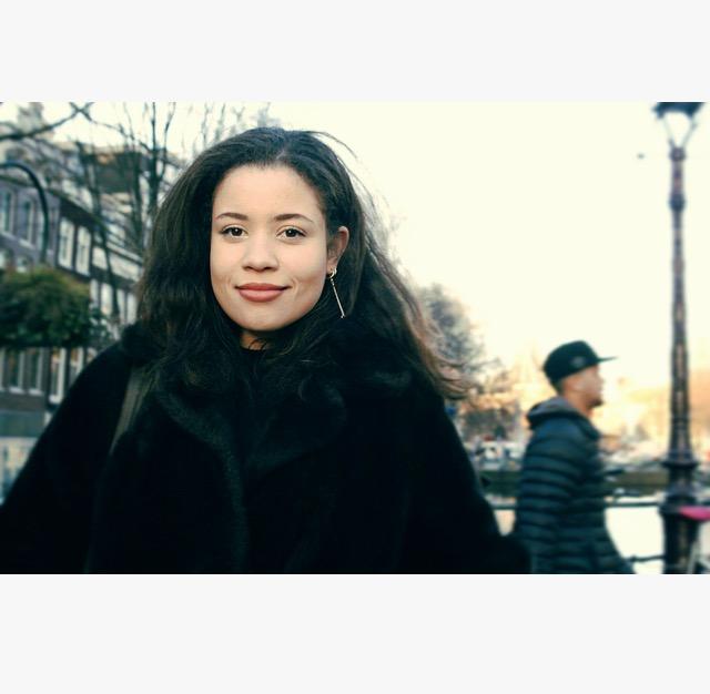 An image of Eboni standing on an Amsterdam bridge