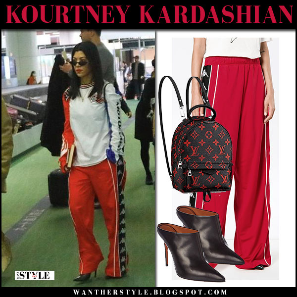 Kourtney Kardashian in red track pants airport street style february 26