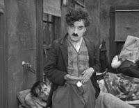 """Чарли Чаплин и его буйные кудри в """"Малыше"""""""