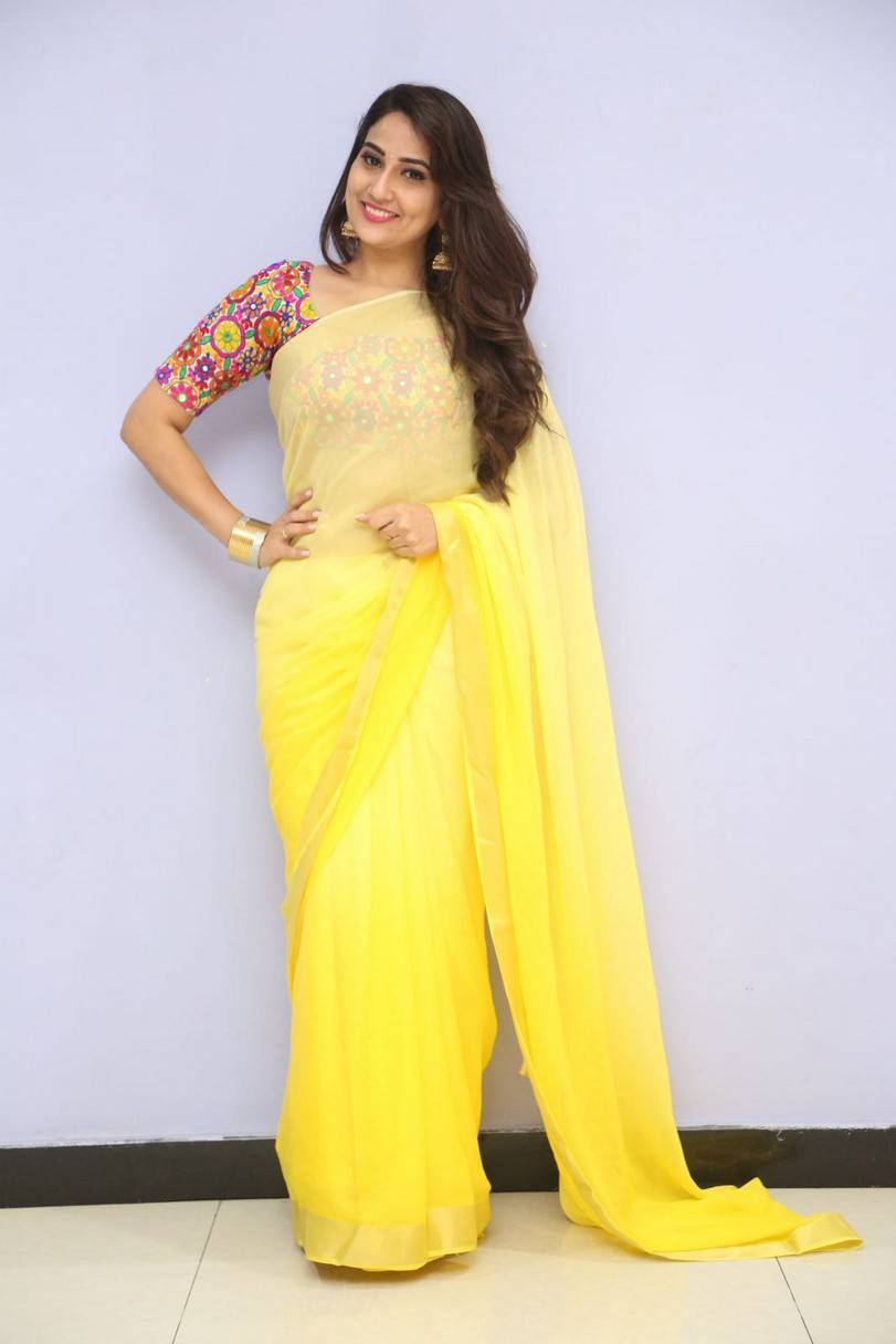 Tv Anchor Manjusha Long Hair Stills In Yellow Saree