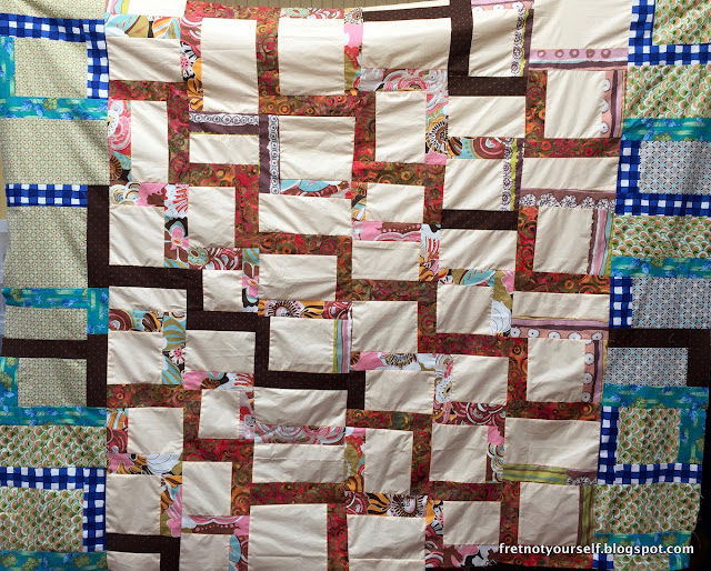 Center section in cream, brown, orange, pink. Outer borders in green and blue