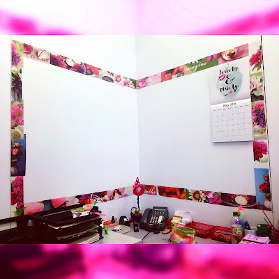 making a border in the corner of an office wall to create a bulletin board space above a desk