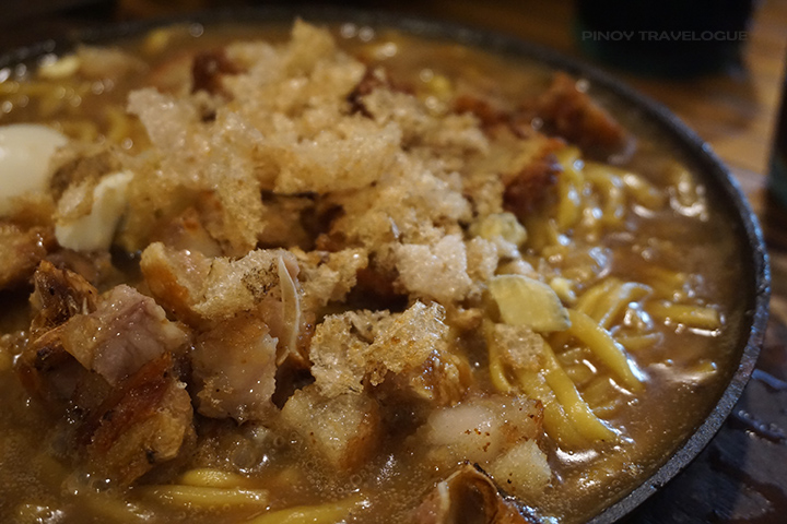 Sizzling lomi toppings overload