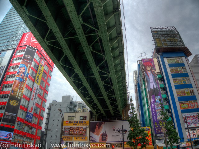 a steel train viaduct through Akihabara electric town