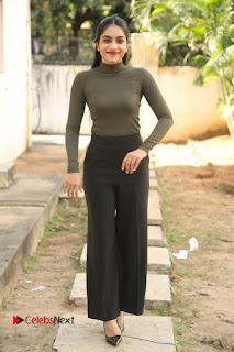 Tollywood Actress Punarnavi Bhupalam Latest Po Gallery in Black Trouser Pant at Pittagoda Movie Interview  0146.JPG