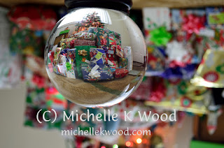 Christmas gifts through a crystal globe