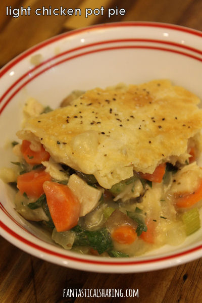 Light Chicken Pot Pie // This lighter version features Greek yogurt and one crispy crust on top that is incredible! #recipe #chicken #potpie #pie #maindish