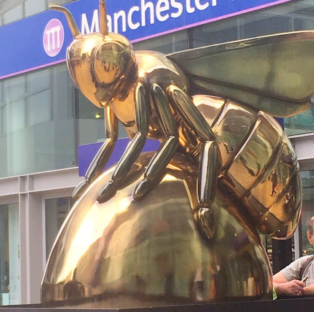 Manchester bee outside Piccadilly station