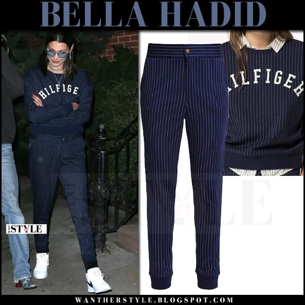 Bella Hadid in navy striped sweatshirt, navy striped pants tommy hilfiger and white sneakers what she wore april 2017
