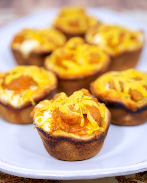 Buffalo Chicken Cupcakes - frozen popcorn chicken, buffalo sauce, ranch and cheddar baked in crescent cups - great for lunch, dinner or a party! Quick appetizer and snack recipe.