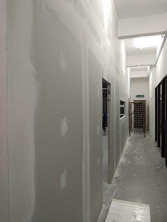 Kerja melepa atau plastering drywall