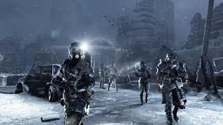 Three men wearing gas masks and holding assault rifles patrol the ruins of Moscow in the snow, from Metro 2033