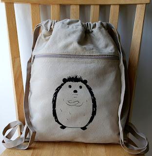 cute hedgehog backpack sitting on a chair