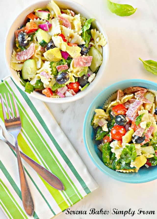 Italian Antipasto Pasta Salad With Basil Vinaigrette recipe is a summertime favorite for  lunch, dinner, picnics and barbecues. It's filled with salami, artichoke hearts, olives, red pepper, and feta cheese from Serena Bakes Simply From Scratch.