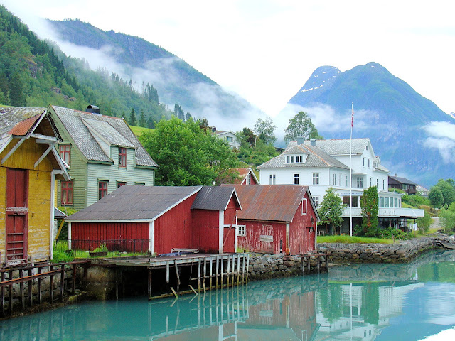 A similar view of the enchanting village of Fjærland shows not much has changed in 100 years. The white building in the background is the Fjærland Fjordstuer Hotel. Photo: EuroTravelogue™.