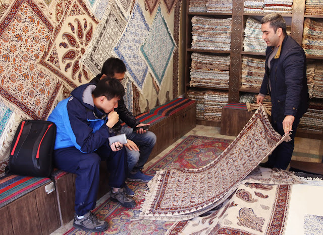 Travelers watching Ghalamkar textiles of Isfahan. Iran