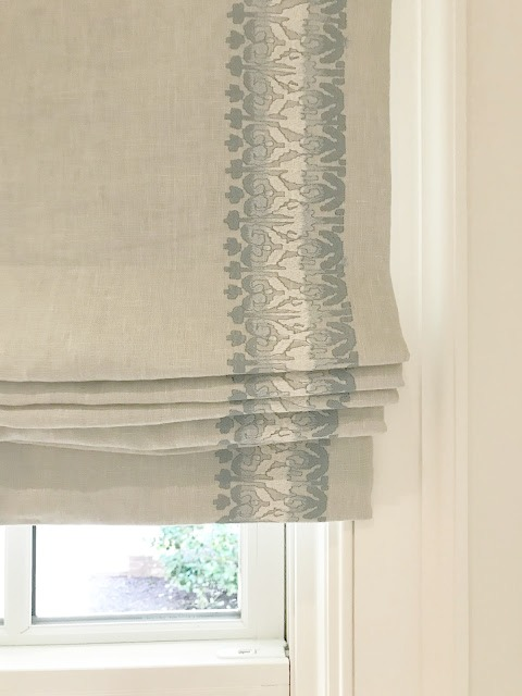 Linen roman shade with blue and cream embroidered detail in kitchen of Southeastern Designer Showhouse 2017.