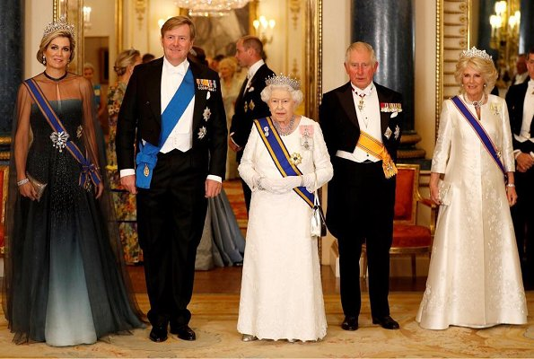 Kate Middleton's wearing Lovers Knot Tiara, Diana's Collingwood earrings and blue McQueen gown. Maxima' Jan Taminiau gown and Steward Tiara