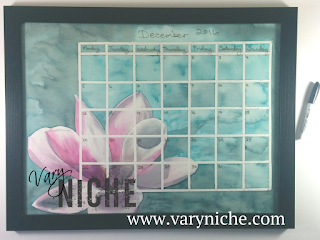 Vary Niche Fine Art Whiteboard Calendar with a magnolia on a marbled turquoise background.