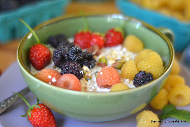 fresh berries on homemade muesli cereal